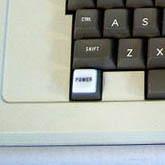 Apple ][ keyboard with raised Power light.