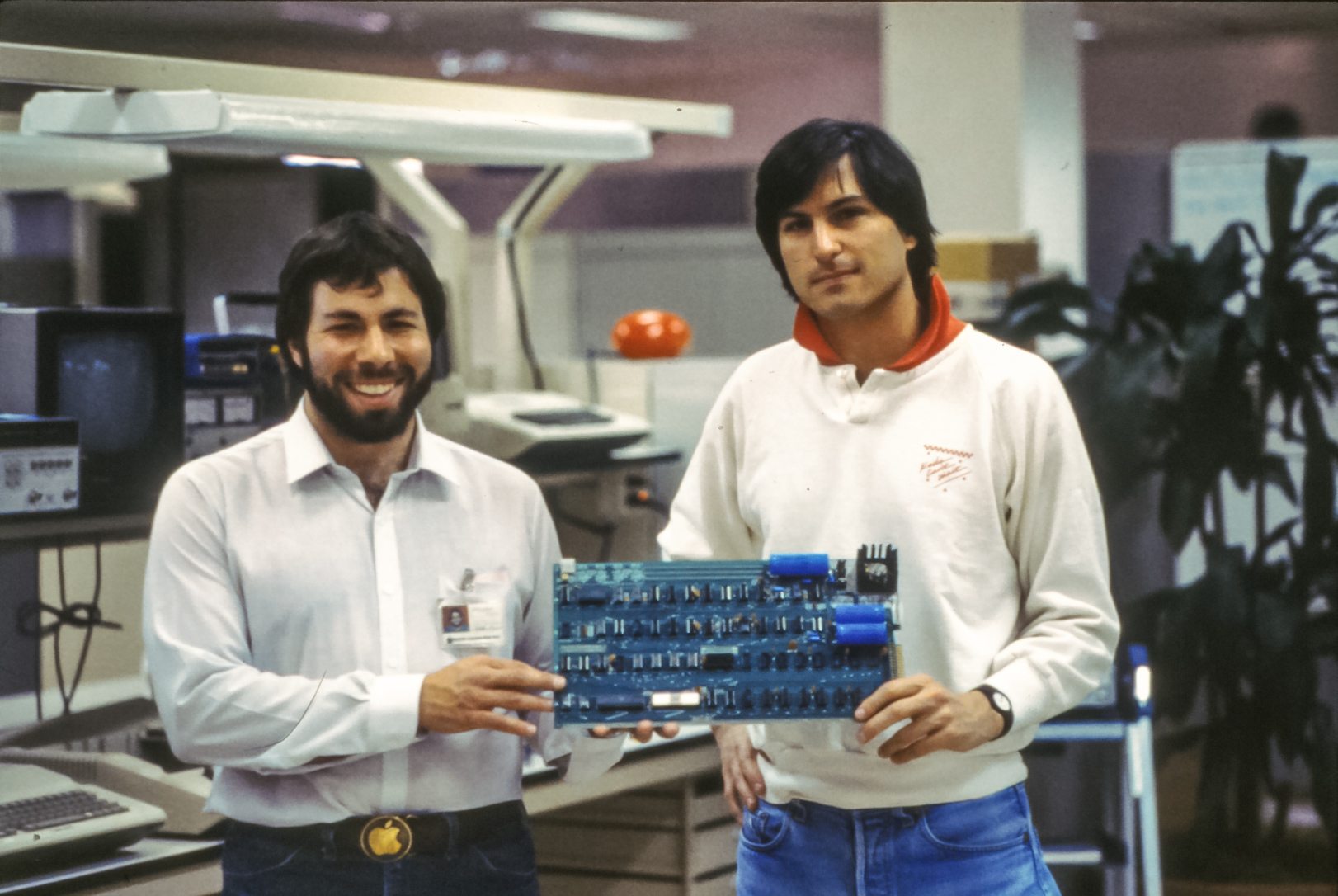 Steve Wozniak and Steve Jobs holding an Apple-1 computer board