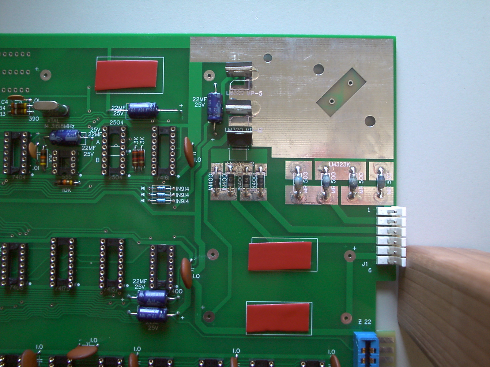 Small patches of sticky tape on Apple-1 PCB
