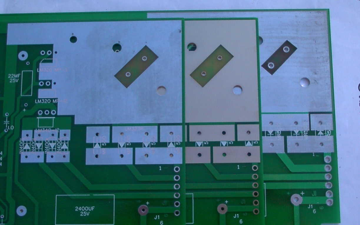 Closeup of the LM323 heat sink area. Note different PCB sizes.