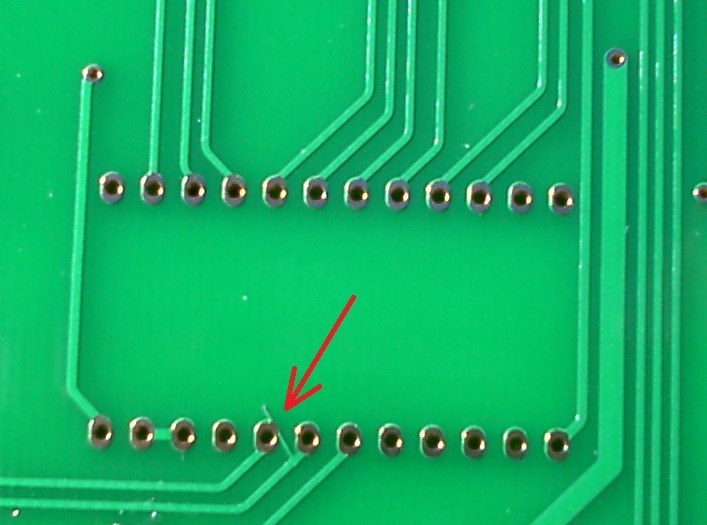Short on PCB (red arrow)
